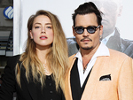 Source Claims Johnny Depp Offered Amber Heard Money to Stay Silent About Alleged Domestic Violence