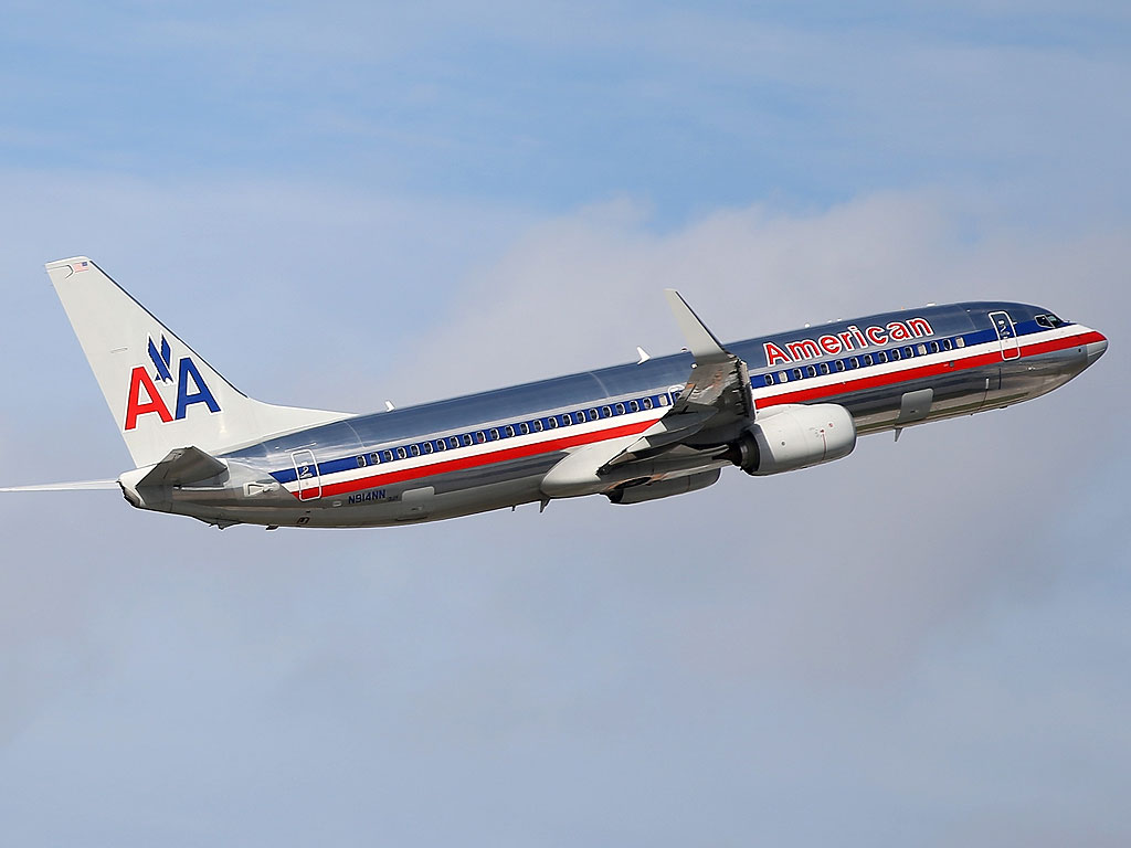 Flight Attendant Charged with Lighting a Fire Aboard American Airlines Jet