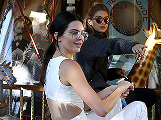 Life's a Carousel! Kendall Jenner and Gigi Hadid Ride a Merry-Go-Round During Runway Break