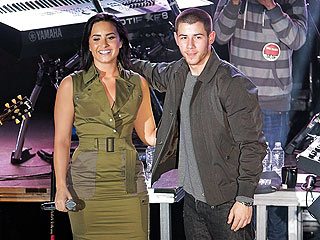 Want to Lounge Backstage and Snap Selfies with Demi Lovato and Nick Jonas During Their Tour? You'll Need $10,000