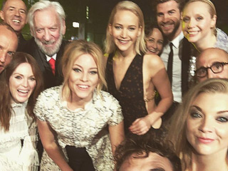 Group Selfie! Jennifer Lawrence, Liam Hemsworth and Hunger Games Cast Pose at London Premiere