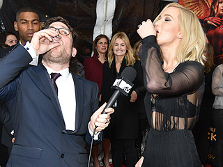See Jennifer Lawrence Throw Back a Shot of Bourbon on The Hunger Games Red Carpet (Her Costars Let Loose Too!)
