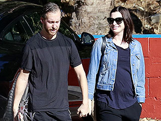 PHOTO: Pregnant Anne Hathaway Takes a Sweet Stroll with Her Husband