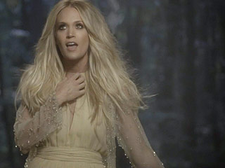 FROM EW: Watch Carrie Underwood Trot Barefoot Through the Woods in New Video for 'Heartbeat'
