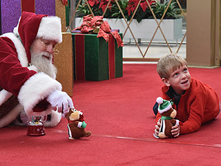 Kind Mall Santa Gets on the Floor for Boy with Autism: 'I Thought We Would Never Get Those Holiday Pictures,' His Mom Says