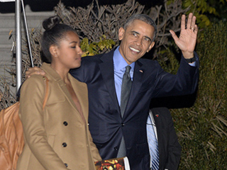 President Obama and First Family Stop in San Bernardino Before Heading to Hawaii for Christmas Vacation