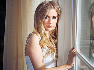 Cover Story: Avril Lavigne Opens Up About Her Secret Health Crisis