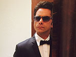 John Stamos Takes PEOPLE Inside His Emmys Day (and for a Dip in His Pool!)