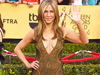 Jennifer Aniston Wears a Body Chain (Again!), Shows Off Cleavage and 'Cabo San Lucas' Tan