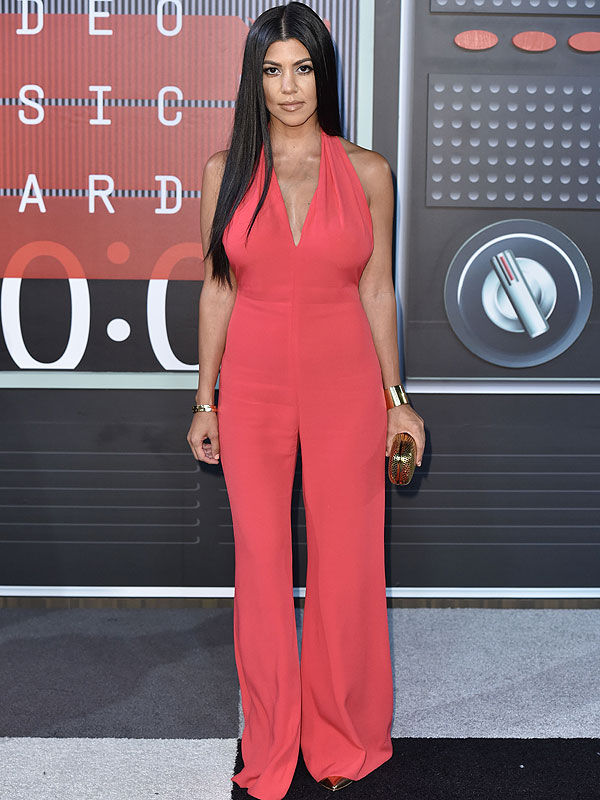 Kourtney 39 S Plunging Pink Jumpsuit Kylie 39 S Sexy Wig The Kardashian Jenner Krew Goes Glam As