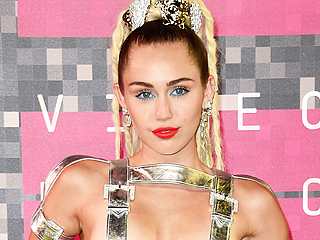 Miley Cyrus Opts for Silver Suspenders (and Nothing Else) for First VMA Look