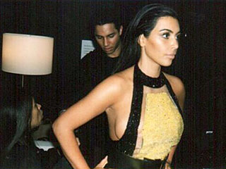 See Kim Kardashian Squeeze Into 'Damn Sample Sizes' While Kanye Looks On