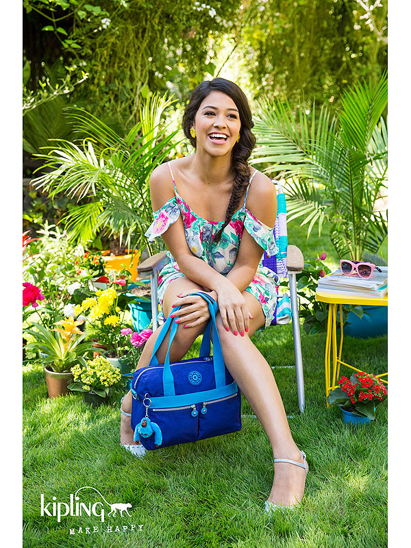 Gina Rodriguez posing for Kipling USA