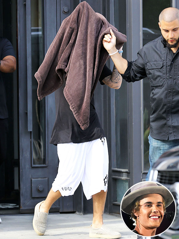 Justin Biebers Haircut Is So Shocking He Left The Salon With A Towel Covering His Head