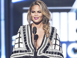 Chrissy Teigen Pulls 5 Cleavage-Baring Looks at Billboard Music Awards, Snacks on Cupcakes Between Outfit Changes