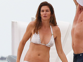 Cindy Crawford, 49, Shows Off Her Incredible Bikini Body in Snakeskin-Print Two-Piece