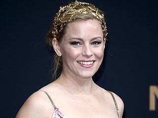 Elizabeth Banks's Hunger Games Premiere Gilded Headband Has Us Swooning
