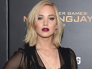Jennifer Lawrence Slays Hunger Games Red Carpet in Sheer Schiaparelli Gown at New York Premiere