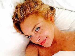 Lindsay Lohan Posts Makeup-Free, Topless Selfie From Bed