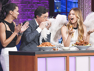 See Stephen Colbert Wipe Chicken Wing Sauce with Behati Prinsloo's Victoria's Secret Wings!
