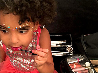 A Little More Lipgloss! Beyoncé Shares Photo of Blue Ivy Playing with Her Makeup