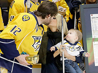 Carrie Underwood's Son Isaiah Watches Mom Steal a Kiss as Mike Fisher Celebrates His 1,000th NHL Game