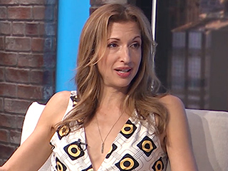 Alysia Reiner Gets Extremely Honest About Taking 'Deeply Romantic' Breaks Alone with Her Husband: 'We Need Sex with Noise!'