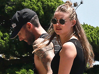 Behati Prinsloo Shows Off Growing Baby Bump By the Pool: 'Belly Button Still on Point'