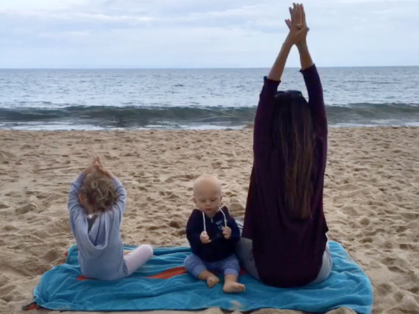 Hilaria Baldwin kids beach yoga