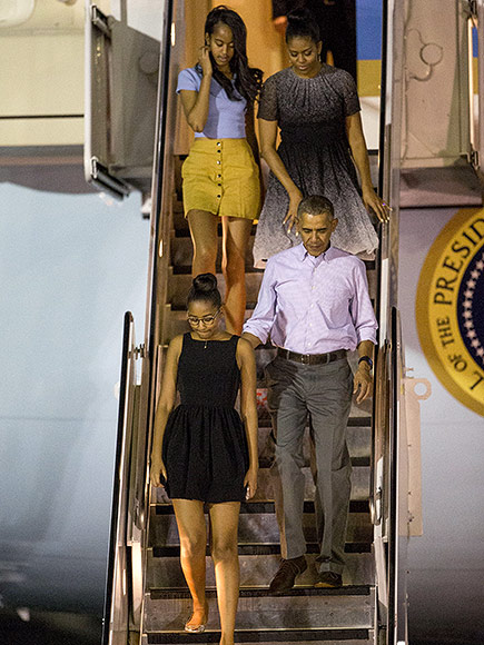 the obamas land in hawaii for annual vacation
