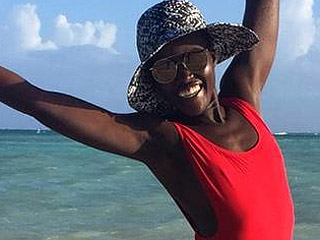 Lupita Nyong'o Looks Toned and Happy in Red One-Piece Swimsuit (Photo)