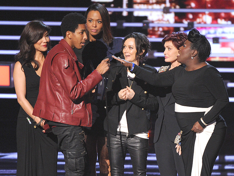 Watch Sharon Osbourne Give the Boot to a Serial Party Crasher Who Tried to Steal the Show at People's Choice Awards| People's Choice Awards, Kanye West, Sharon Osbourne