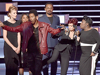 Watch Sharon Osbourne Give the Boot to a Serial Party Crasher Who Tried to Steal the Show at People's Choice Awards