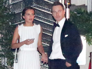 Going Public: Michael Fassbender and Alicia Vikander Flash PDA, Hold Hands at Golden Globes Afterparty