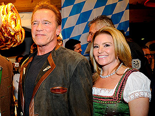 I'll Be Back: Arnold Schwarzenegger Wears a Traditional Outfit and Snacks on Pretzels During Trip Back Home to Austria with Girlfriend