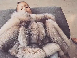 Diva-in-Training! North West Tells Mom Kim Kardashian 'No Pictures' While Lounging in Fur Coat