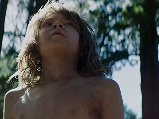FROM EW: The Pete's Dragon Teaser Trailer Is Finally Out of the Woods – Watch