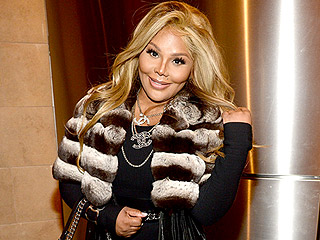 FROM EW: Lil' Kim Teases 'Sexy, Gangsta' New Music, Remembers Biggie Smalls