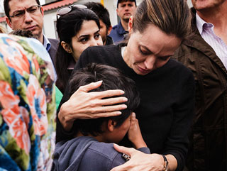 Angelina Jolie Pitt Comforts Emotional Syrian Refugee Children During U.N. Trip to Greece