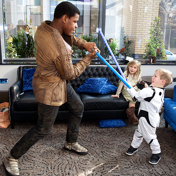 Cute Alert! John Boyega Surprises Sick Children with Star Wars Toys| Star Wars, Real People Stories, John Boyega