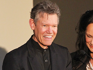 Randy Travis' Silence Speaks Volumes as He Accepts Hall of Fame Honor
