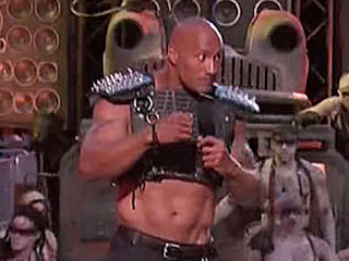 Revving Up the Show! The Rock & Kevin Hart Rib Mad Max (and Themselves!) in MTV Movie Awards Opener