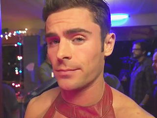 Zac Efron Sports Booties and Red Leather Dress in Neighbors 2 Teaser: 'Sorry, Mom'
