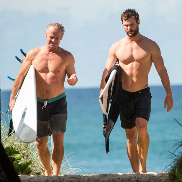 Chris Hemsworth Shows Off His Six-Pack While Surfing in ...