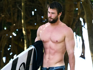 Chris Hemsworth Shows Off His Six-Pack While Surfing in Australia with His Father