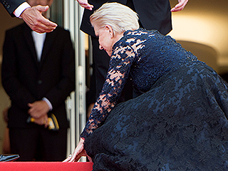 Helen Mirren Keeps Her Cool After Losing Her Footing on the Cannes Stairs