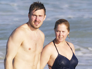 Amy Schumer and Ben Hanisch Take a Dip in the Ocean While Celebrating Their Six Month Anniversary in Hawaii