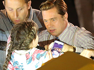 Brad Pitt Helps Rescue Young Fan from Being Crushed by Crowd on Set of Allied