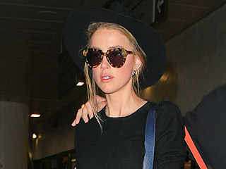 Amber Heard Appears Noticeably Thinner at LAX After Restraining Order Hearing with Johnny Depp Is Delayed
