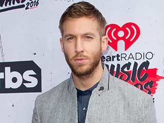 Calvin Harris 'in Great Spirits' at the Club While Surrounded by a Bevy of Girls